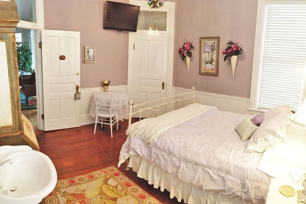 The Summer Hill room is decorated in warm cheerful colors and has its own flat-screen television and detached full bathroom.