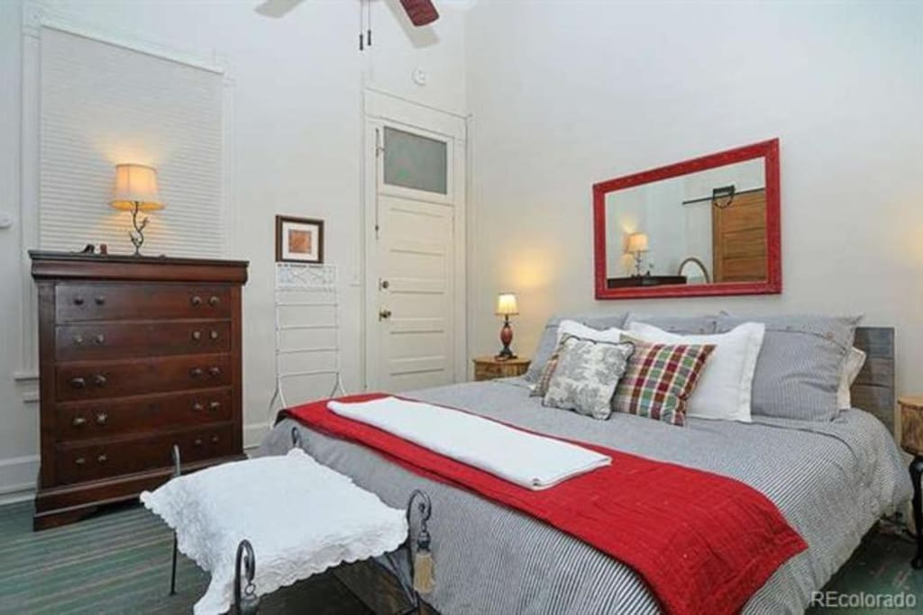 The king-size bed in this light and airy room offers supreme comfort. Rest up after hiking the local trails!