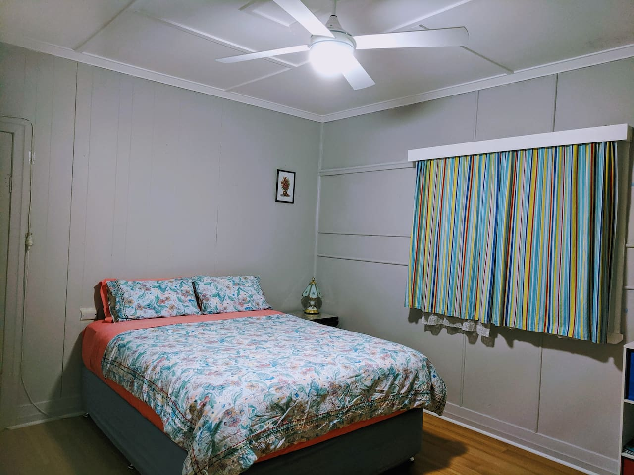 Spacious room has a comfortable bed, a ceiling fan and two windows if you love to have your windows open