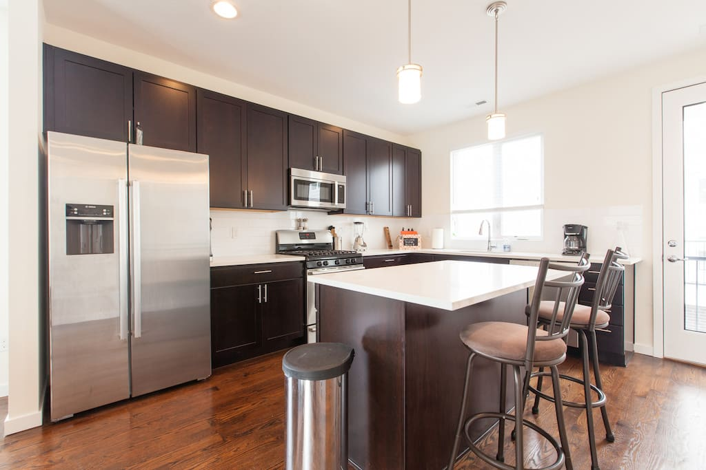 Gourmet kitchen with brand new high-end appliances.