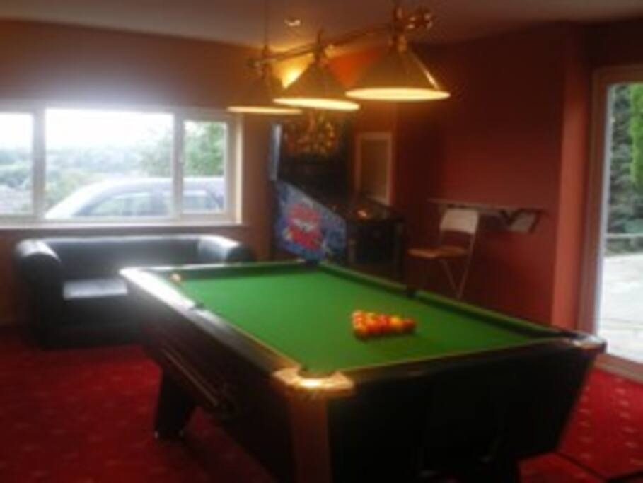 Games room with pool table, darts, table football and football game machine