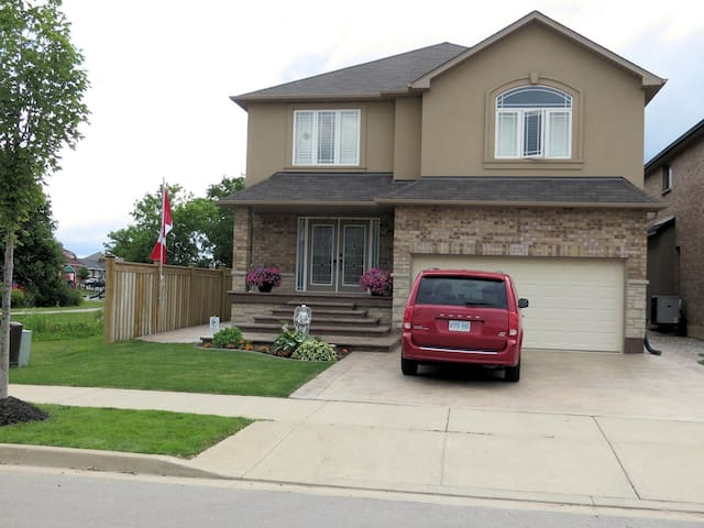 Front of the property, it is located right beside a park.