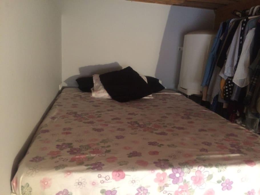 Super comfortable double bed in mezzanine.