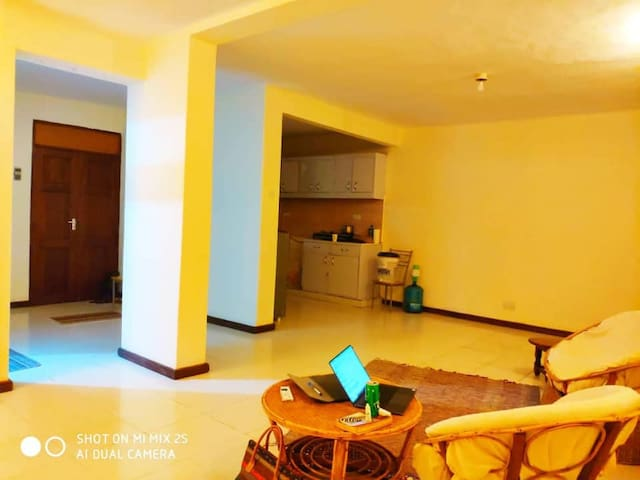room 1-Minute Walk from Acacia Mall  in 2-br flat