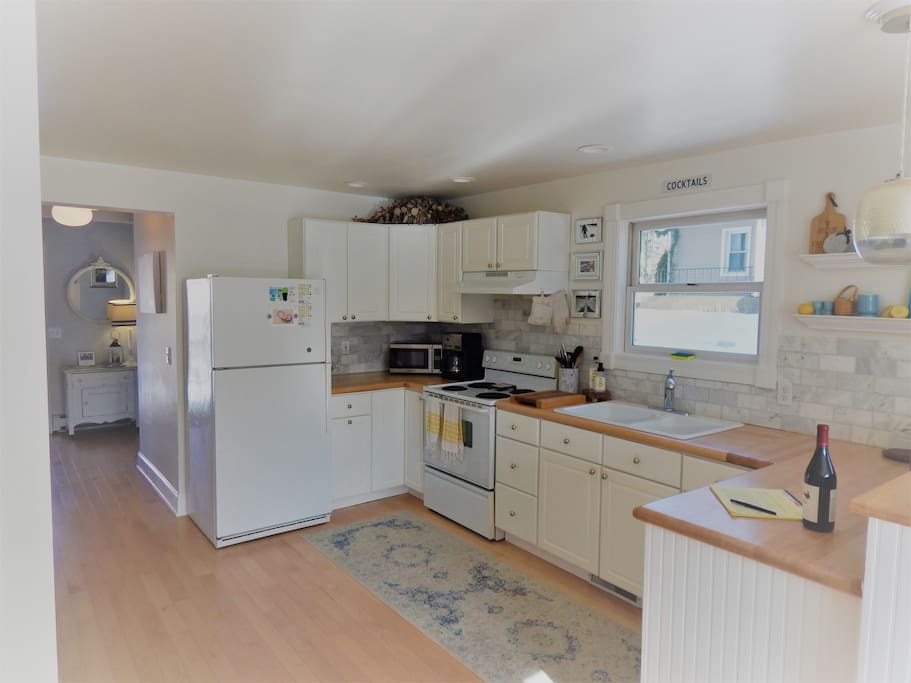 Clean and bright kitchen with maple block countertops and anything you would need to cook a feast