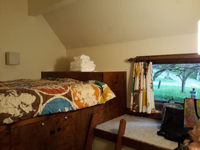This is our loft bedroom.  It has a double bed that's about 4 1/2 feet up and accessed with a ladder.  There is no close.  Single young adults and children will be comfortable but neither couples nor older folk should use this room.