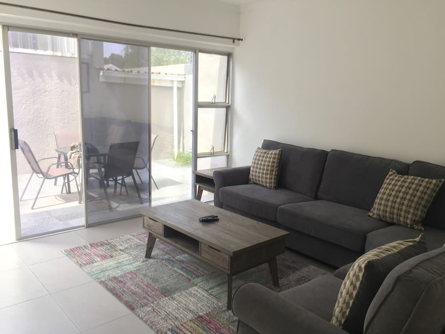 Bright, spacious lounge opening onto outside patio area