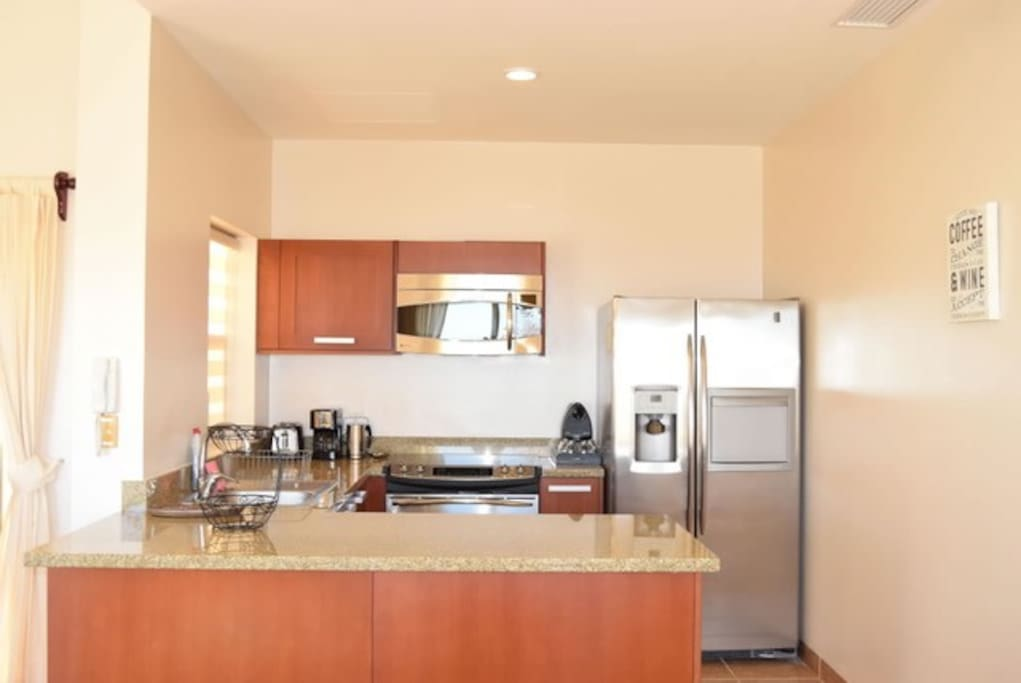 Fully equipped kitchen with dishwasher, fridge and oven.