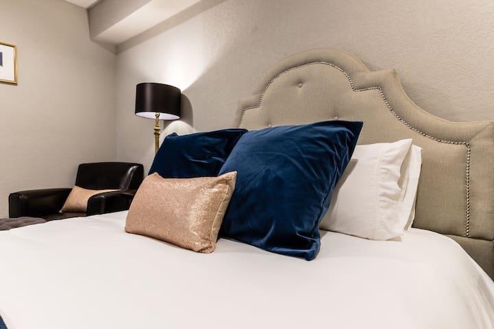 Crisp white linens on a Posturpedic mattress. Heaven!