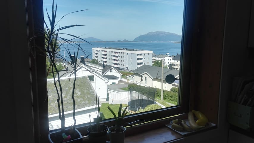 An apartment with a view of the Ålesund city.
