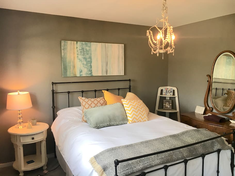 Queen bed with brand new memory foam mattress + a variety of pillows to suit your sleep style. Antique dresser, plus a portion of the custom-designed California Closets closet, to store your clothes.
