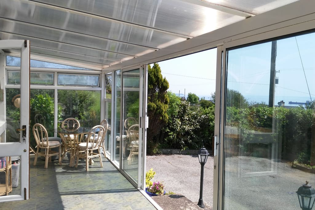 Large front conservatory, provides two seating areas for alternative sociable spaces for chatting and enjoying the view or morning yoga, exercise or reading whatever takes your fancy.