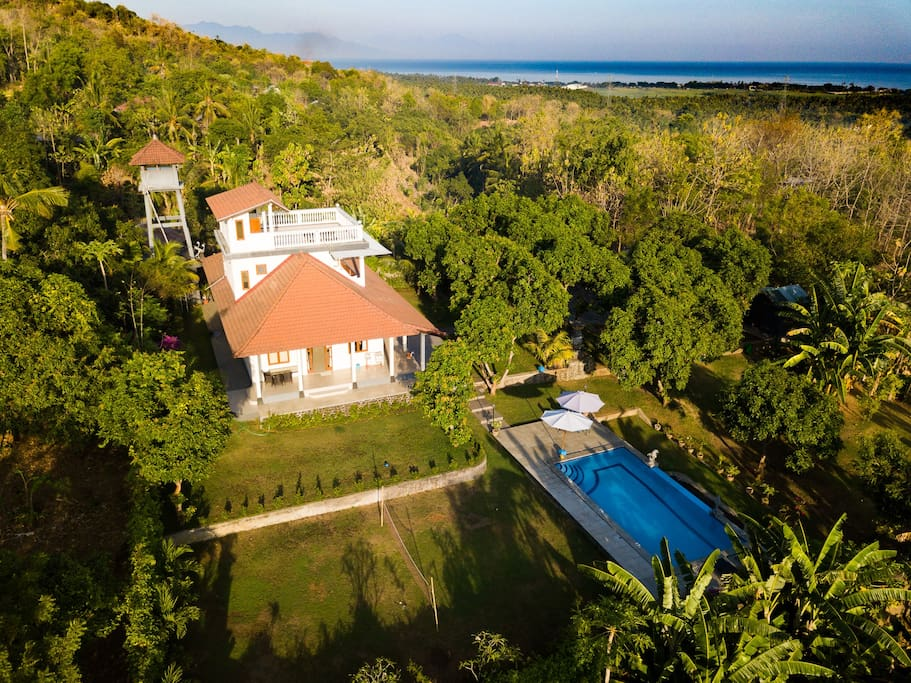 The villa from the air overlooking the sea, the best views are from the roof terrace