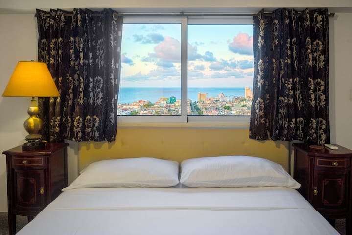 Master bedroom with bathroom in suite, sea and city view