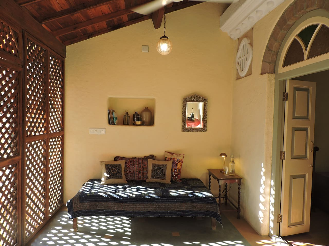 Enter your room via the courtyard in to this light-filled dayroom before entering the bedroom.