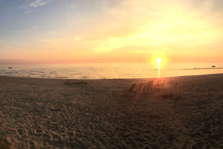 The beautiful sand beach at sunset
