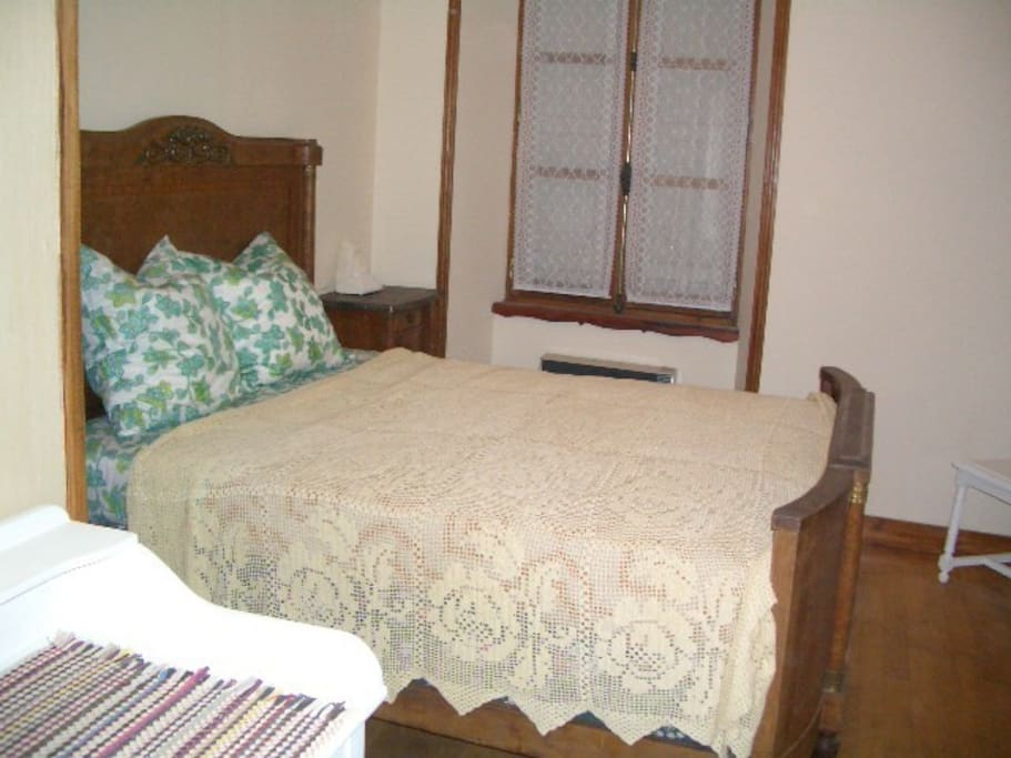 Spacious double room with dressing room area.