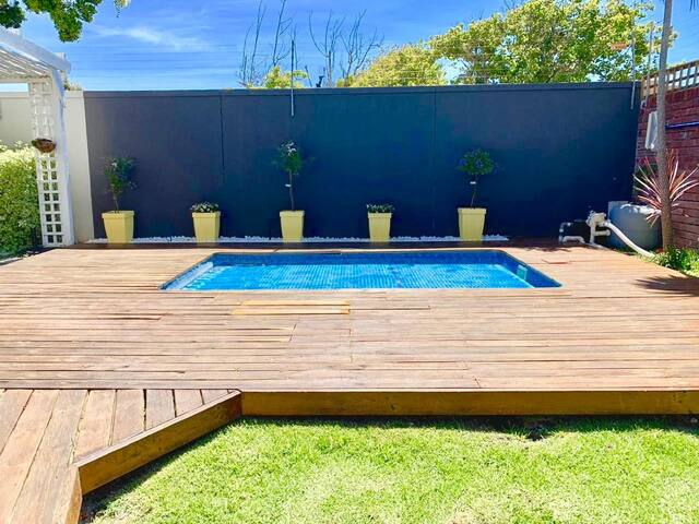 Front garden and solar heated splash pool