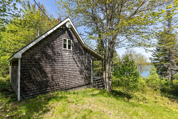 Dog-friendly, waterfront home w/ a full kitchen, wood stove, kayaks, & views
