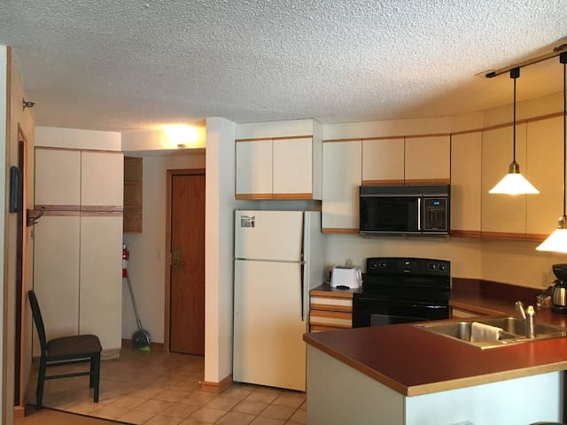 Full kitchen with dishwasher and storage