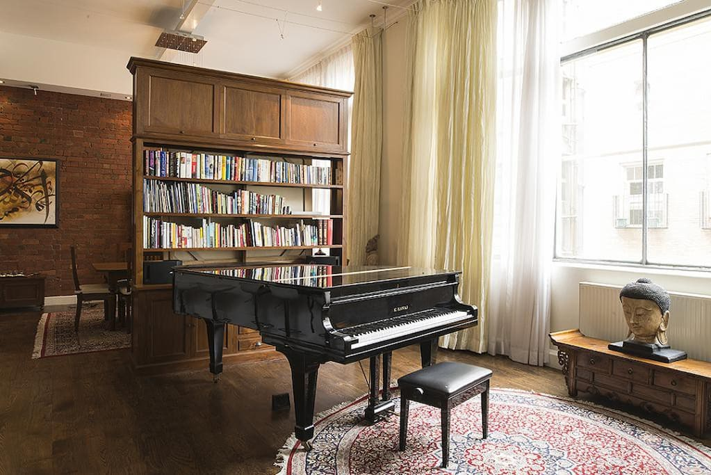 You'll love the entertainment zone with a grand piano