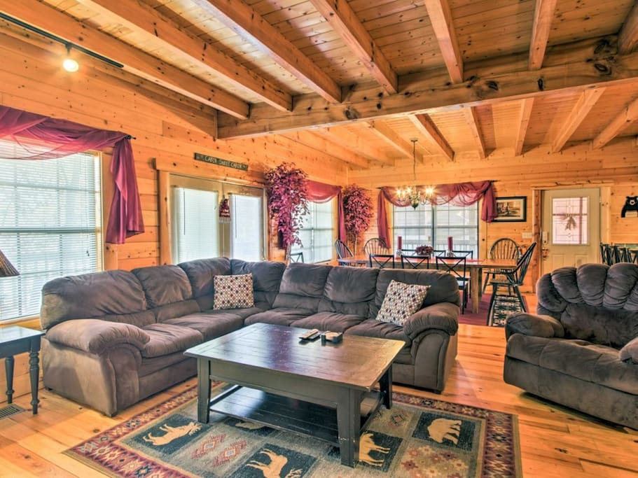 Open-plan living with hardwood beams and floors