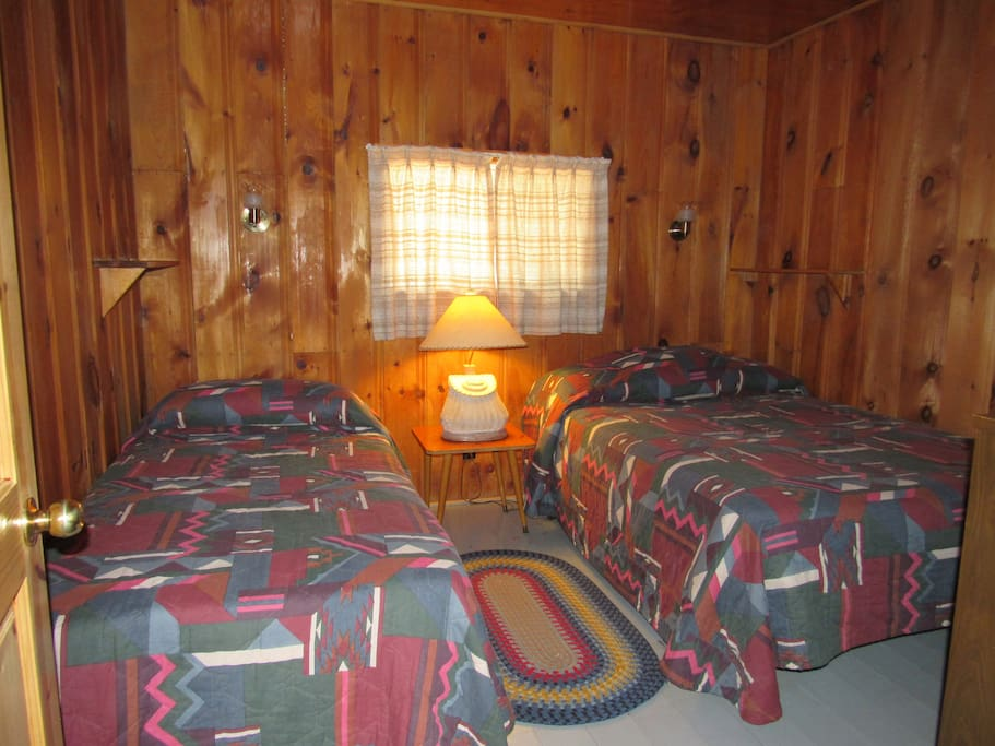 Two bedrooms, including one with a double bed are pine-clad and comfortable.