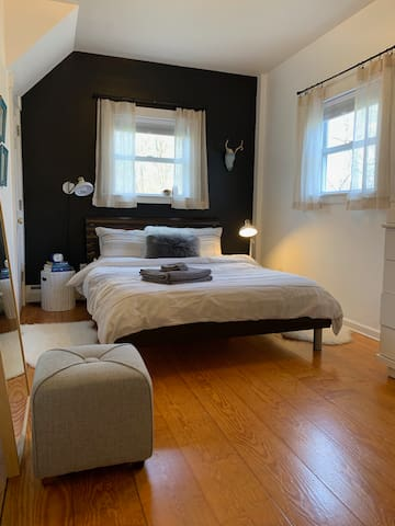 Bedroom has a queen size bed