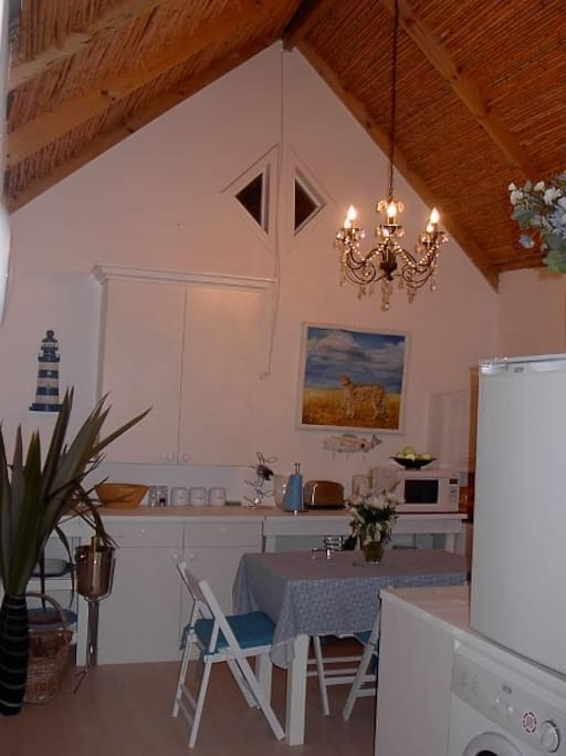 Kitchen with stove,microwave,bar fridge,water cooler,toaster,kettle,washing machine,tumble dryer,cooling fan