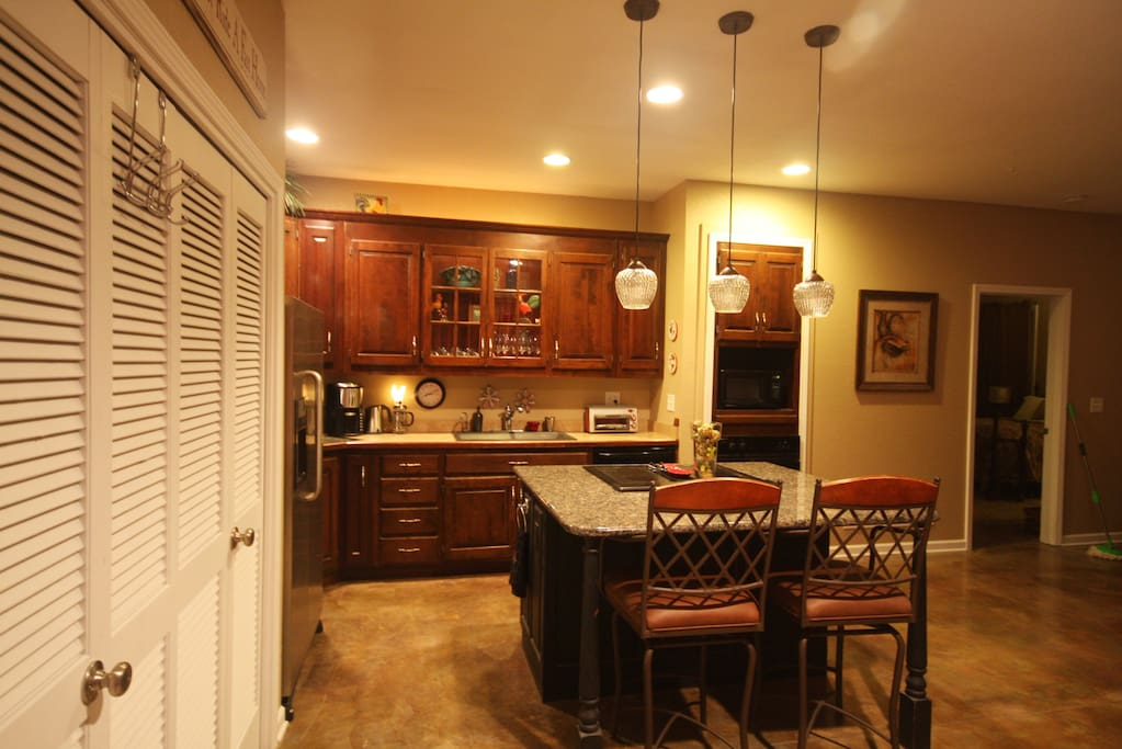 Kitchen is furnished with cooking utensils, plates, silverware and small appliances. Appliances include frig, stove top, wall oven, microwave, dishwasher & garbage disposal.