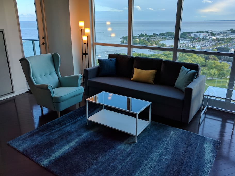 Evening picture: Stunning view overlooks the Waterfront, Ontario Place, CNE, and 33 acre Coronation Park.  Oak hardwood flooring throughout most of this stunning ~1100sqt suite!