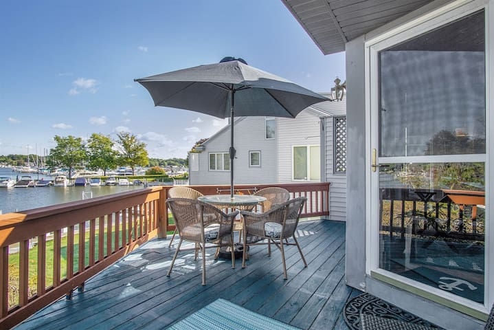 Comfortably Numb: Views of the Saugatuck Harbor cannot be beat from this beautiful 2 level condo with association swimming pool