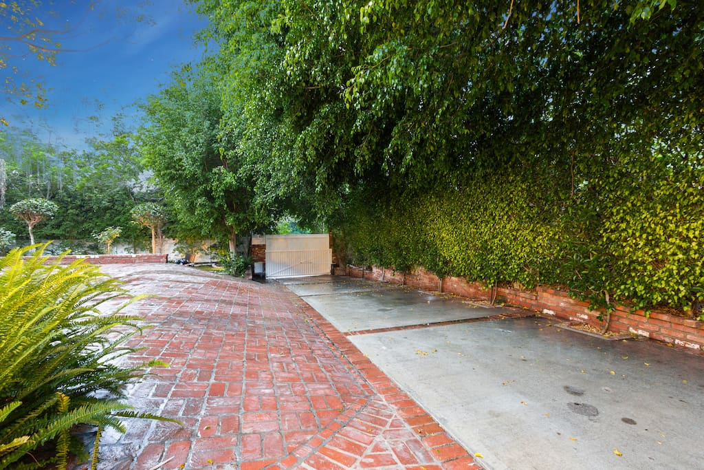 Private Gated Entry With Grand Driveway