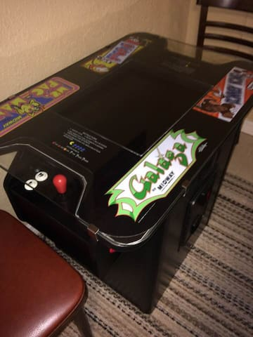 This arcade unit has 60 games including Pac Man, Galaga, Donkey Kong and Frogger, many more classic favorites. Insert a quarter (provided) and you'll be able to scroll through 60 games, 10 pages of games with 6 games on each page. Most of the favorite games are on the first page or two, and on page 10 there is a version of Ms. Pac Man and Galaga in which you get 5 lives instead of just 3 lives so you can go for the high score! Please treat this expensive antique with respect! ;)  (reproduction actually, new)
