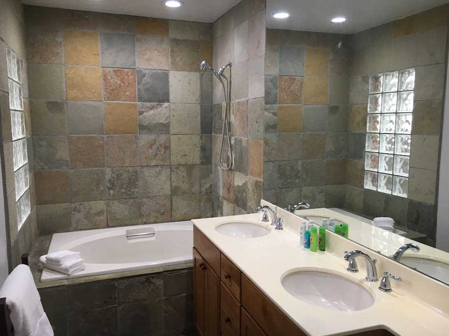 For added comfort there is a heated towel warmer, dual sinks and a light switch dimmer.