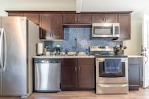Professional Series Kenmore stainless steel appliances with all pots, pans and more for cooking.