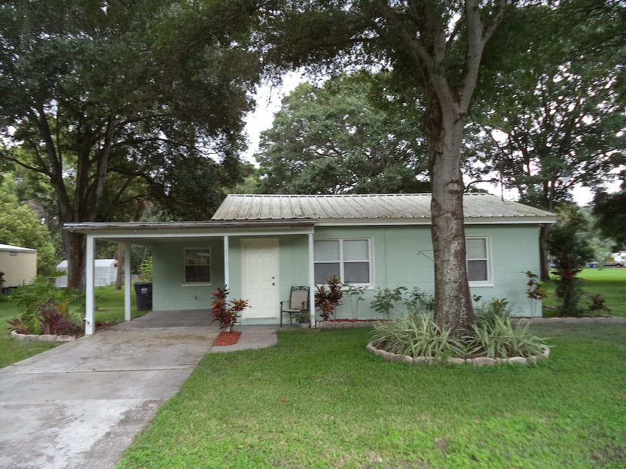 Home is 2/1 located in a quiet neighborhood just outside of the city limits. Private driveway with carport to keep your car cool from the Florida sun.