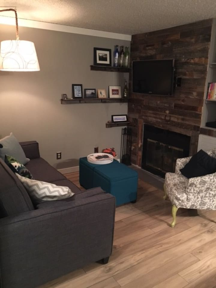 Newly renovated condo with hardwood flooring and couch that opens into full bed.