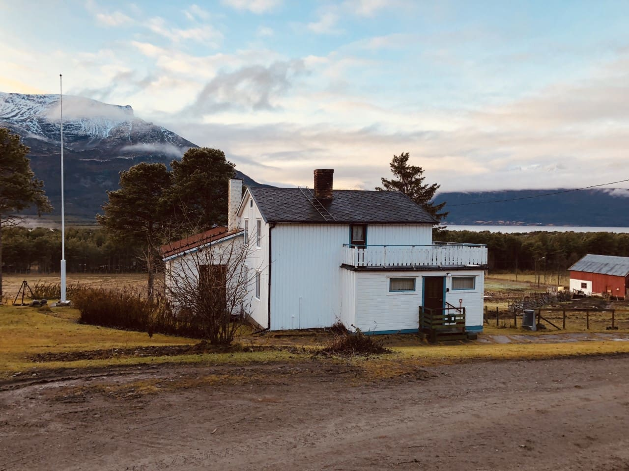 The old farmhouse is placded on top of a slope with a stuning view over the mountanins and the fjord, there is plenty of space outside for campfire or observing northern lights.
