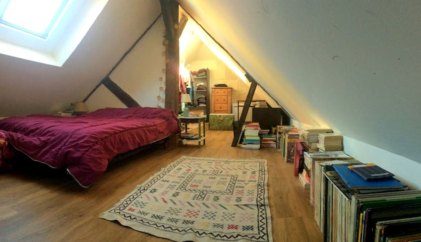 The cozy bedroom, under the rooftops.
