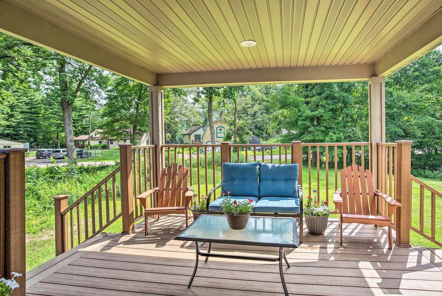 You'll love sitting on the covered porch of this Balsam Lake vacation rental.