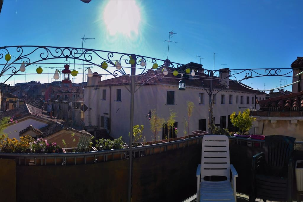 Sunny rooftop terrace with breathtaking view over Venice.