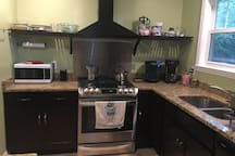 The kitchen was renovated last year with brand new appliances--including a gas range and granite countertops.