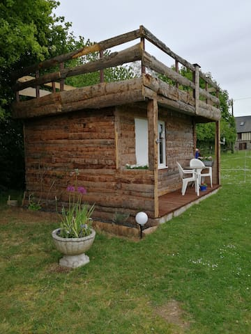 Poppy Cabin is a wooden cabin on a rural campsite