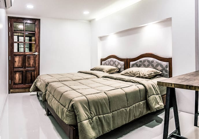 Bedroom #2 - Two single beds with dedicated en-suite bathroom which is good for 2 peoples. This room is on the ground floor next to bedroom #1.