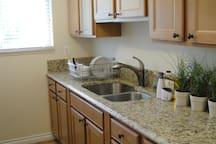 Kitchen with dishwasher, granite counters