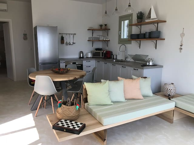The cozy living room with the fully equipped kitchen