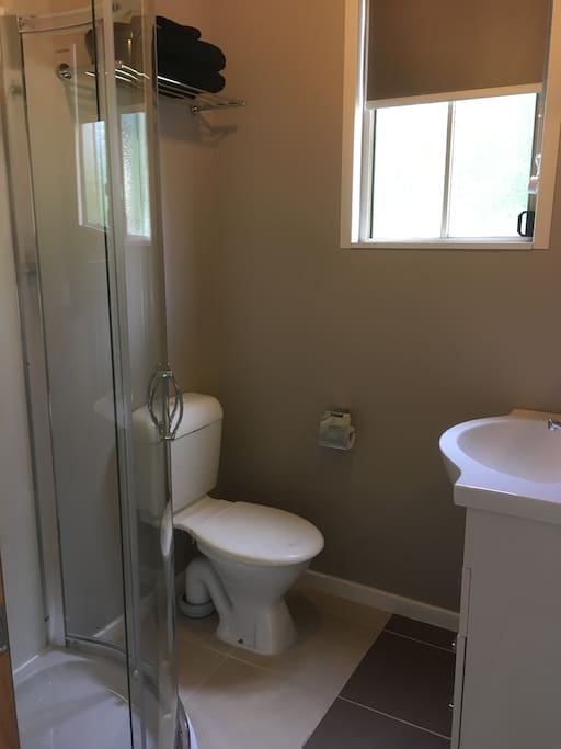 Own bathroom with small shower, toilet, basin.  Towels and soap provided
