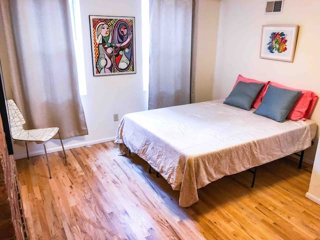 Private guest room has queen bed with memory foam mattress. Amenities include linens, towels and access to a gated private entrance away from the main apartment.