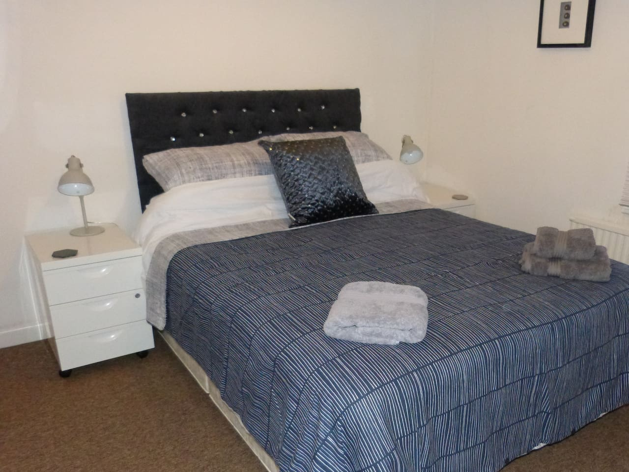Main bedroom with king size bed and memory foam mattress.